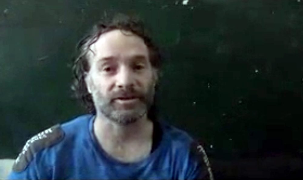 In this image made from undated video obtained by The Associated Press, a man believed to be Peter Theo Curtis, a U.S. citizen held hostage by an al-Qaida linked group in Syria, delivers a statement. (AP Photo)