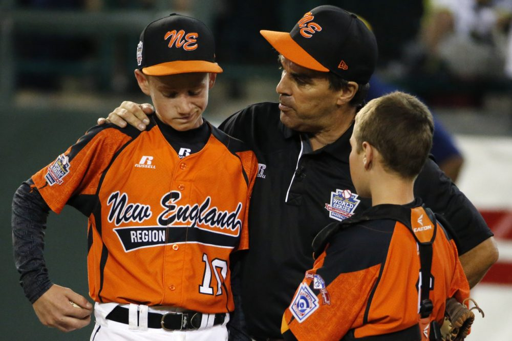 Cumberland manager David Belisle talks with pitcher CJ Davock, left, and catcher Trey Bourque during the fifth inning of the game against Chicago at the Little League World Series on Monday. (AP/Gene J. Puskar)