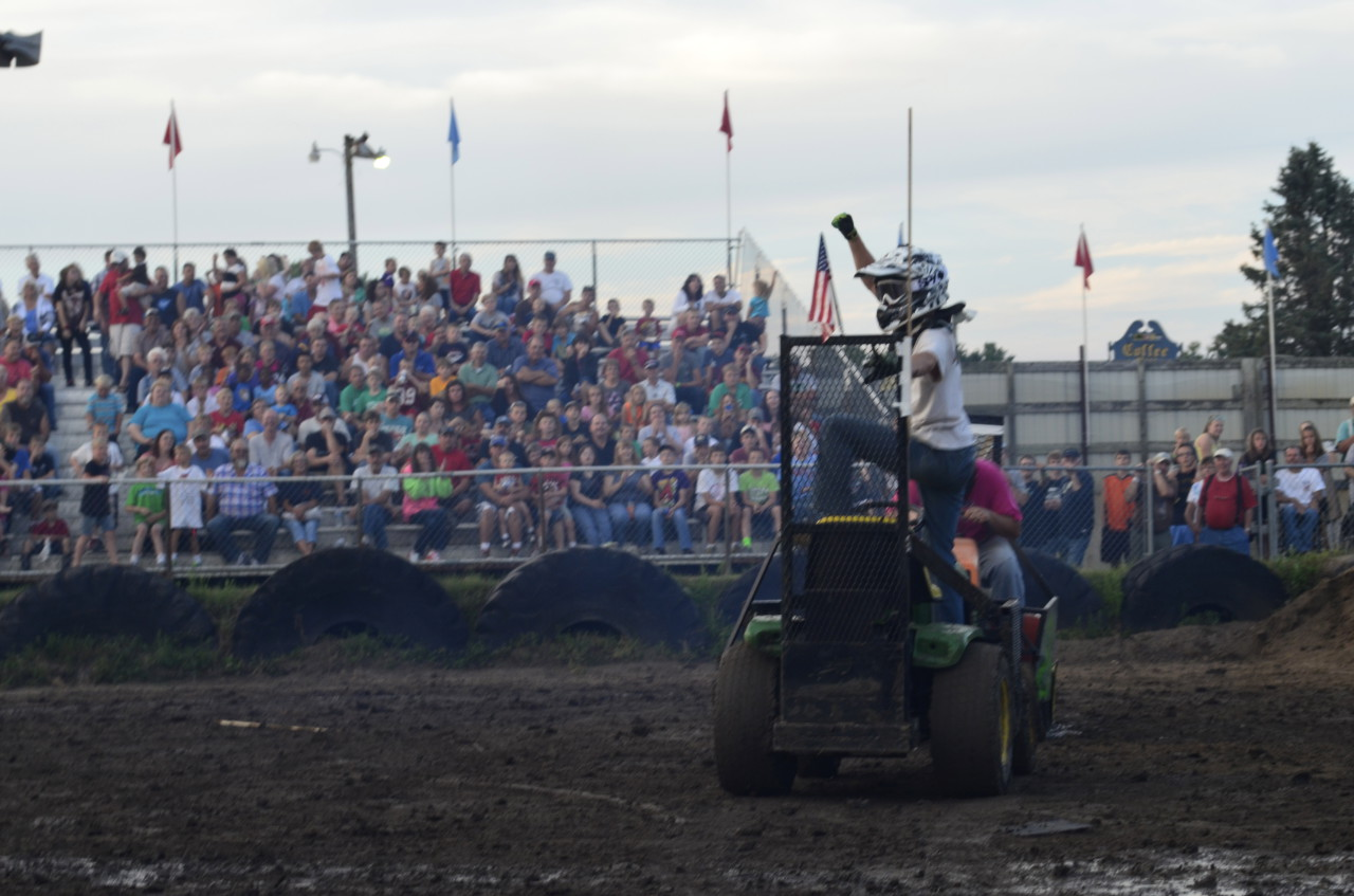 An exuberant winner of one of the heats at the Lawnmower Demolition Derby in Zumbrota, Minn. (Todd Melby/Only A Game)