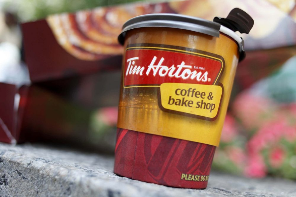 A Tim Hortons' coffee cup is seen in New York, Wednesday, July 22, 2009.  (AP)