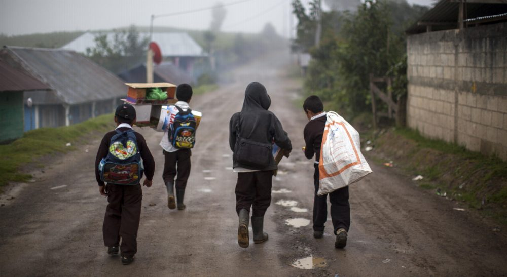"Simon Waxman: ""Tens of thousands of young people are fleeing Honduras, El Salvador and Guatemala thanks to America's war on drugs."" Pictured: Students walk after school in the community of San Jose Las Flores in the northern Cuchumatanes mountains of Guatemala, Tuesday, July 1, 2014. In this small community, Gilberto Francisco Ramos Juarez was born, a Guatemalan boy whose decomposed body was found in the Rio Grande Valley of South Texas. The number of unaccompanied immigrant children picked up along the border has been rising for three years as they flee pervasive gang violence in Honduras, Guatemala and El Salvador. (Luis Soto/AP)"