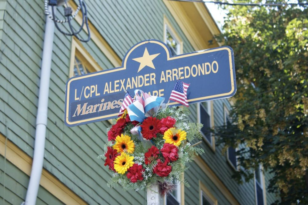 A ceremony today rededicated the corner of St. Rose street and South street in Jamaica Plain to Lance Corporal Alexander Scott Arredondo Square. It is across the street from the house in which Lance Corporal Arredondo grew up. (Qainat Khan/WBUR)