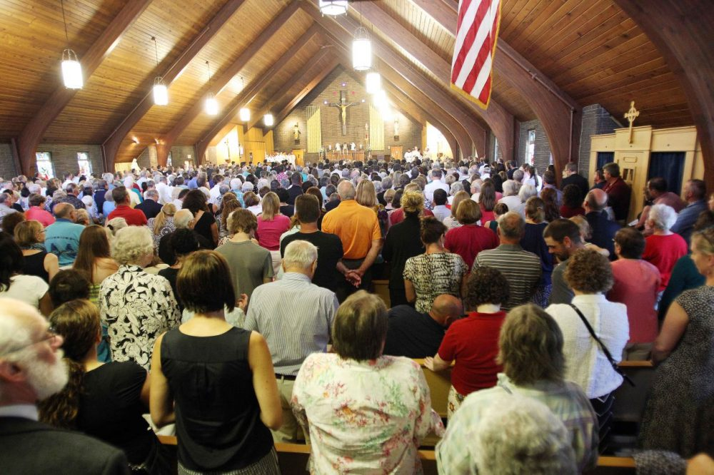 Mourners pack Our Lady of the Holy Rosary Catholic church during a special Mass for slain journalist James Foley in his hometown of Rochester, N.H., on Sunday. (Jim Cole/AP)