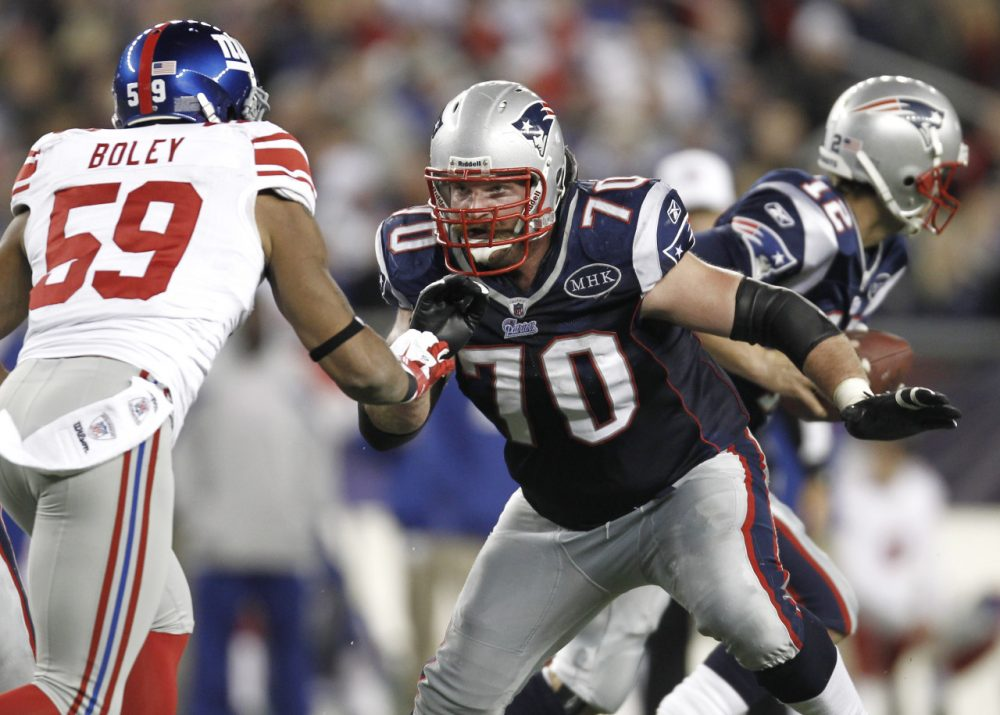 New England Patriots guard Logan Mankins (70) takes on New York Giants outside linebacker Michael Boley in 2011. (Winslow Townson/AP)