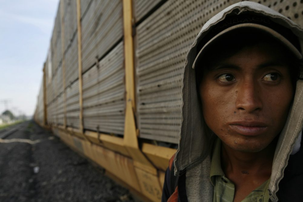 An unidentified migrant from Honduras waits for a northern bound train during his journey toward the US-Mexico border. (AP/Marco Ugarte)