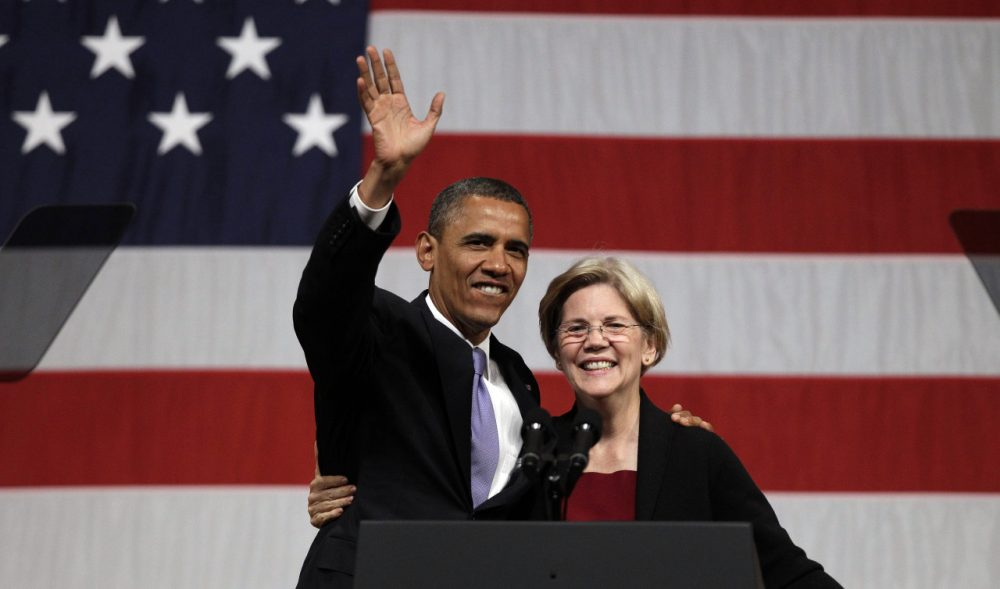 President Barack Obama hugs then-senatorial candidate Elizabeth Warren during a 2012 campaign fundraiser at Symphony Hall in Boston. (AP/Stephan Savoia)