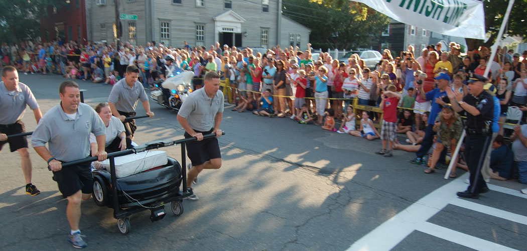 The Newburyport police team closes on the finish line. (Greg Cook)