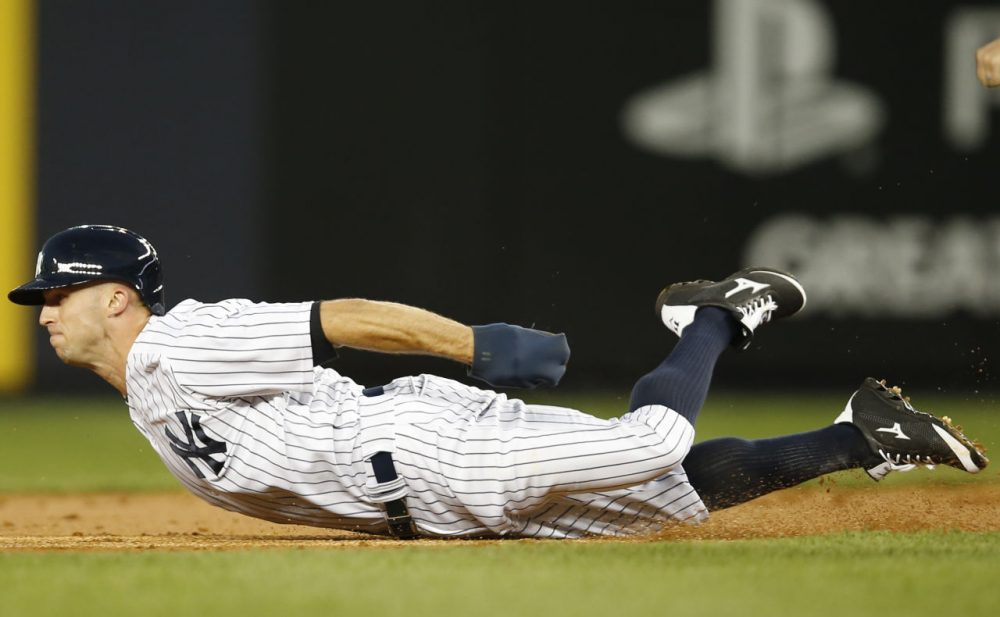 New York Yankees Brett Gardner (11) slides on his belly into second where he was tagged out on a double-steal attempt that turned into a double play in the first inning of a baseball game against the Boston Red Sox at Yankee Stadium. (Kathy Willens/AP)