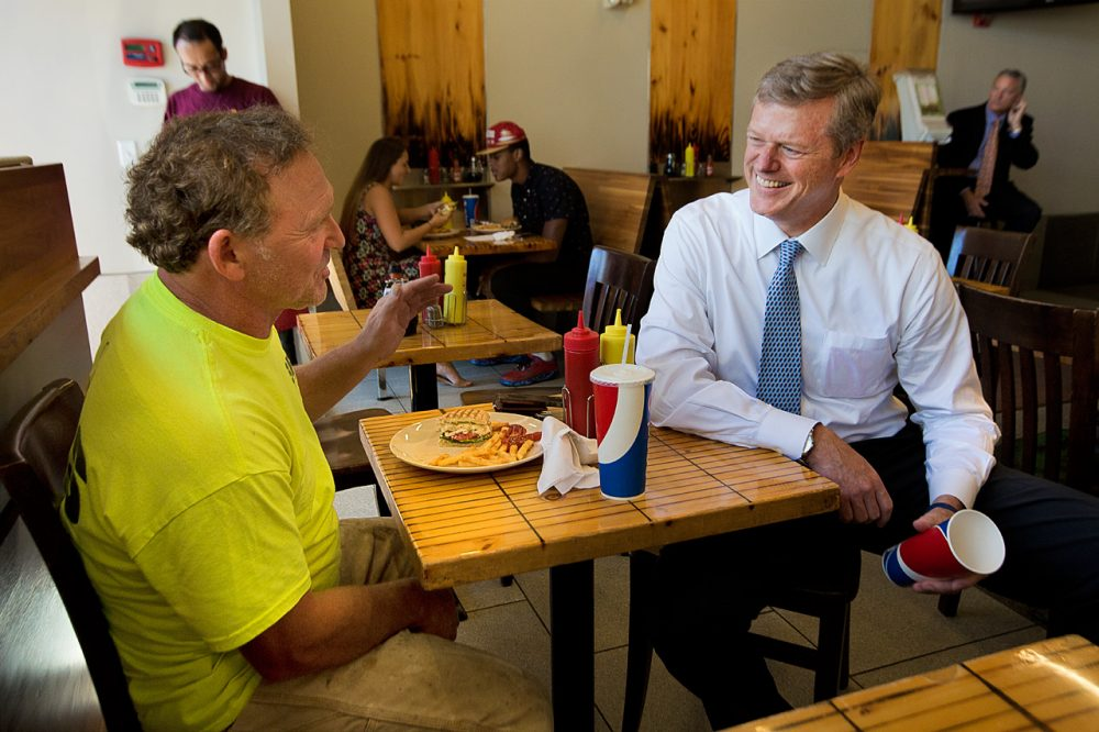 Republican Charlie Baker, right, stops by Eagle's Deli in Boston Thursday. (Jesse Costa/WBUR)