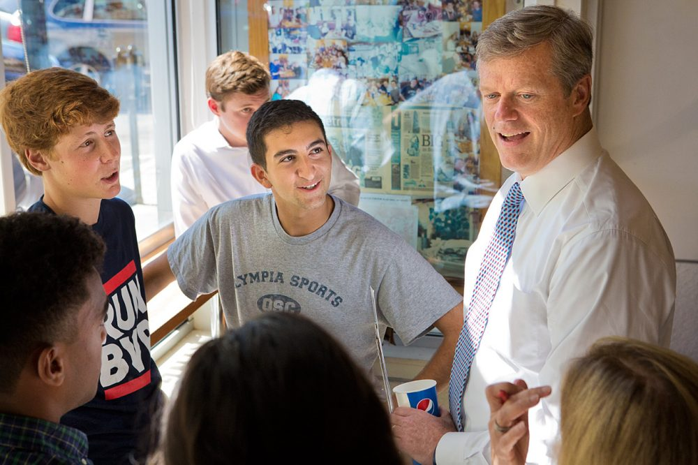 Republican Charlie Baker talks with a group of young people in Eagle's Deli in Boston. (Jesse Costa/WBUR)