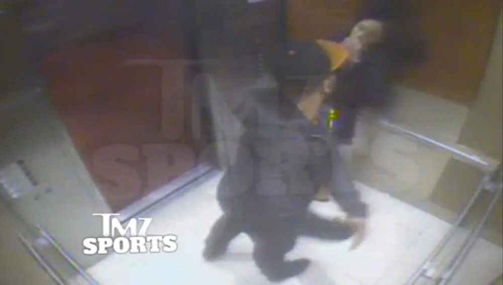 In this still image taken from a hotel security video released by TMZ Sports, Baltimore Ravens running back Ray Rice punches his fiancee, Janay Palmer, in an elevator at the Revel casino in Atlantic City, N.J., in February 2014. (AP)