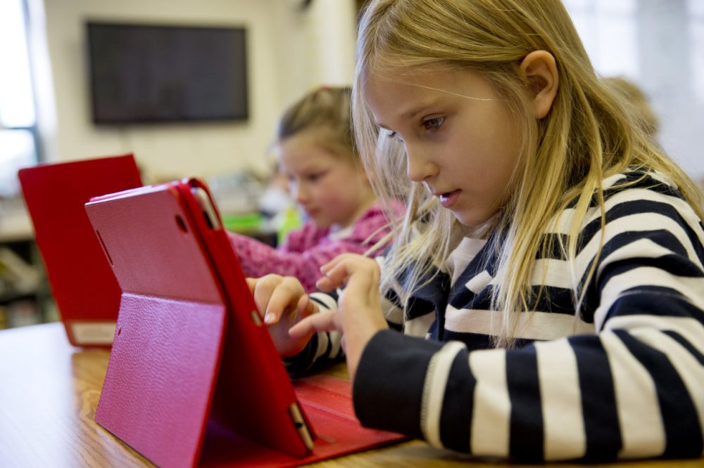 Ella Russell, 7, works on an e-book on an iPad during her second grade class at Jamestown Elementary School in Arlington, Va. (Jacquelyn Martin/AP)
