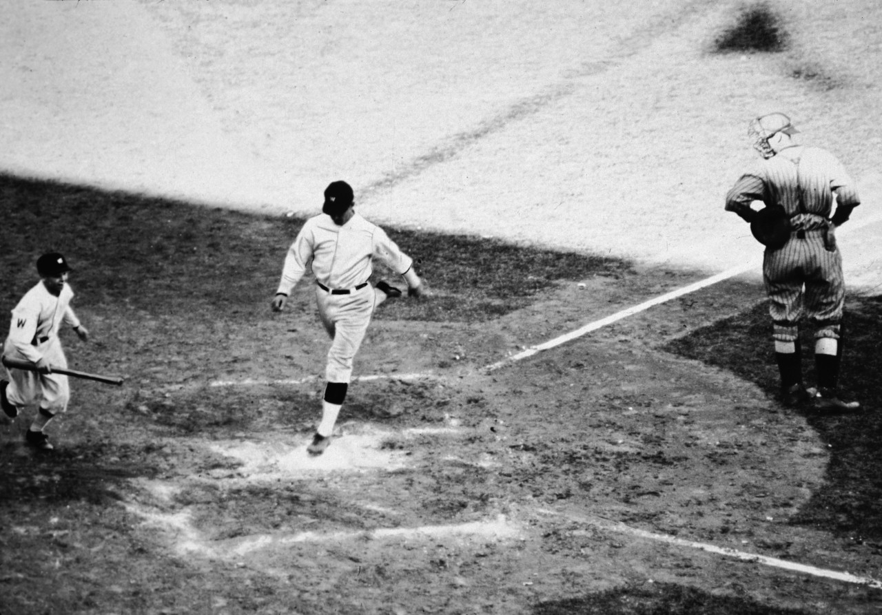 Player-manager Bucky Harris crosses home plate after hitting a home run in Game 7 of the 1924 World Series. (APA/Getty Images)