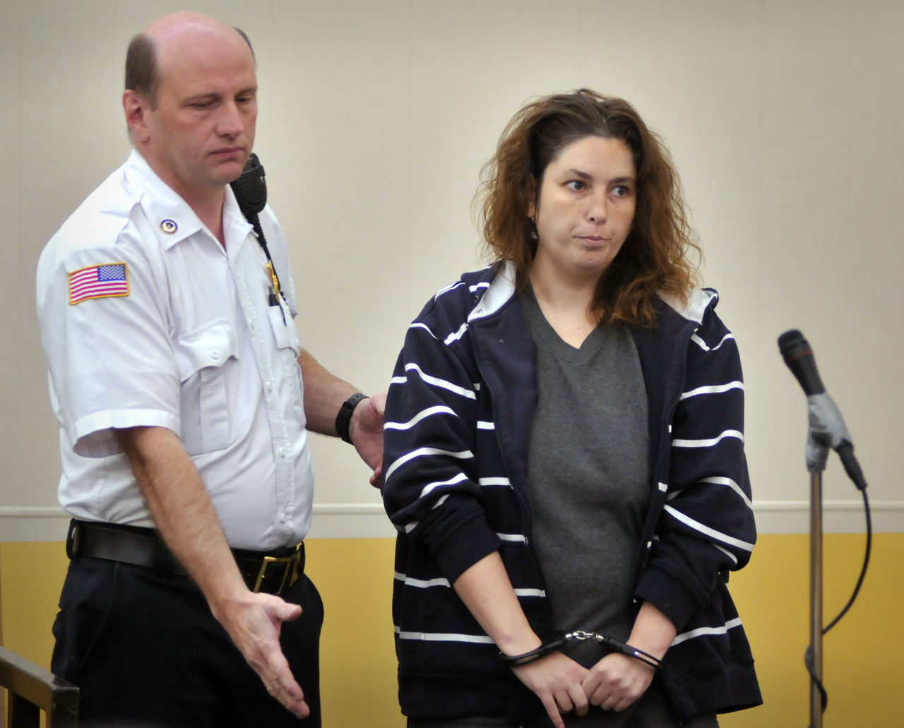 Erika Murray is escorted into a courtroom for her arraignment at Uxbridge District Court in Uxbridge on Sept. 12.  (Paul Kapteyn/AP/Pool)
