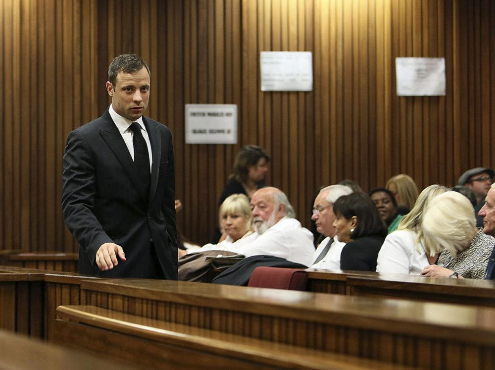 Oscar Pistorius, left, passes family members of the late Reeva Steenkamp on his arrival in court in Pretoria, South Africa, on Friday. (Alon Skuy/AP)