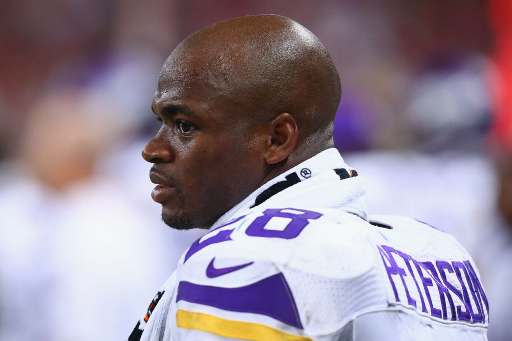 Adrian Peterson has been placed on the exempt-commissioner's permission list, which means he will not be able to participate in team activities. (Dilip Vishwanat/Getty Images)
