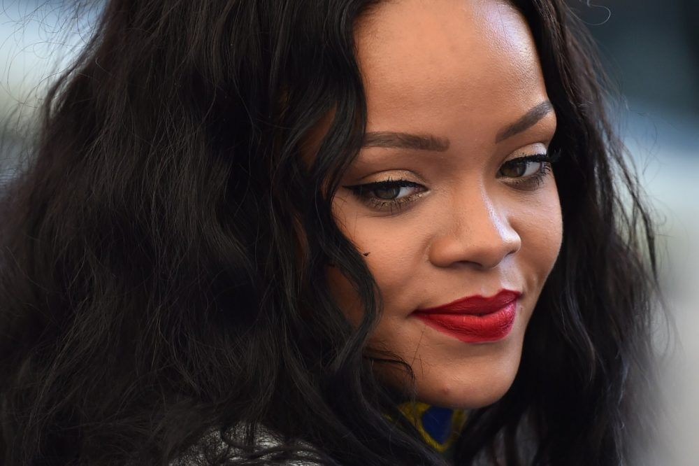 Pop star and domestic violence survivor Rihanna blasted CBS' decision to drop her song from an NFL broadcast. The network then dropped it permanently. (GABRIEL BOUYS/AFP/Getty Images)