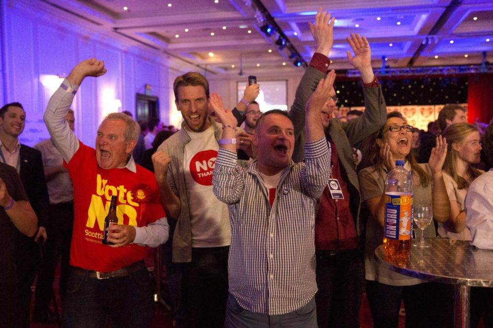 No supporters for the Scottish independence referendum celebrate an early result at a No campaign event at a hotel in Glasgow, Scotland early Friday. (Matt Dunham/AP)