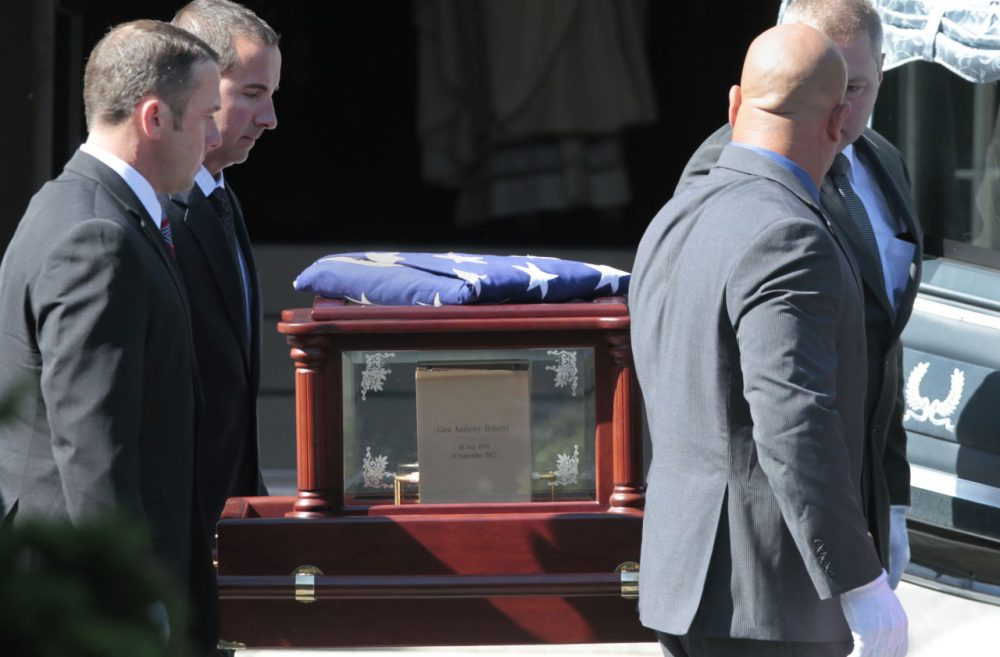 The casket of former Navy SEAL Glen Doherty is carried into the Church of St. Eulalia in Winchester, Mass. in 2012. (Elise Amendola/AP)