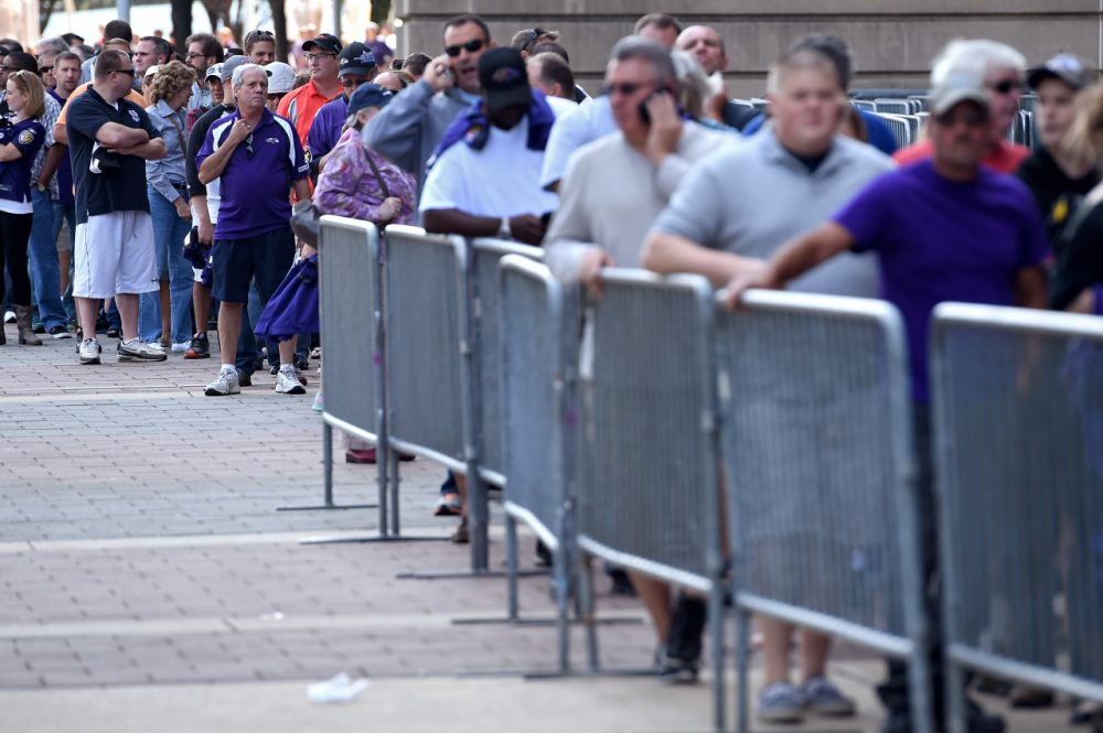 Baltimore Ravens fans stand in line to exchange the jersey of Ray Rice, who is recorded on video knocking out his then-fiance. (Patrick Smtih/Getty Images)