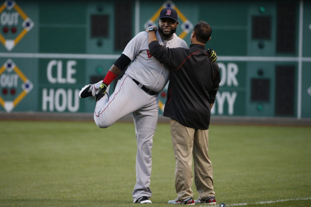 Boston Red Sox's David Ortiz, left, warms up with the help of a team trainer before a baseball game against the Pittsburgh Pirates in Pittsburgh Thursday. (Gene J. Puskar/AP)