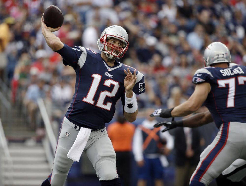 New England Patriots quarterback Tom Brady looks for a receiver against the Oakland Raiders in the first half of the game Sunday, Sept. 21, 2014, in Foxborough, Mass. (Steven Senne/AP)
