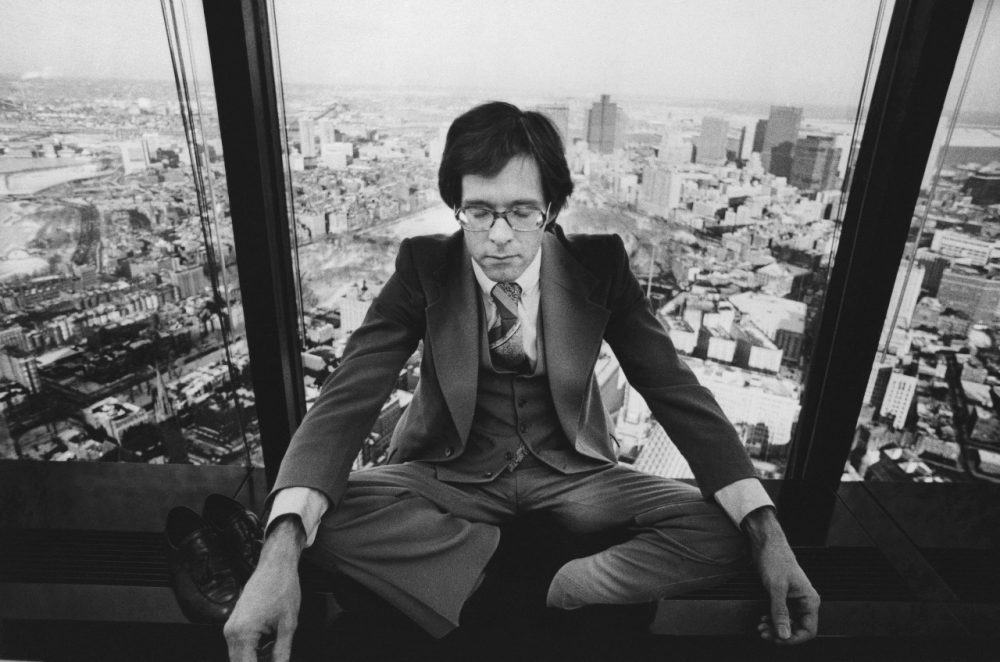 Roy Lobdell an assistant councilor at law meditates during his lunch hour in the tower of the John Hancock Building in Boston on February 4, 1977. (AP)