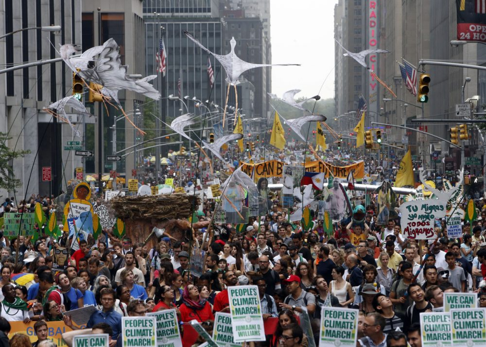 Demonstrators make their way down Sixth Avenue in New York during the People's Climate March Sunday, Sept. 21, 2014. (Jason DeCrow/AP)