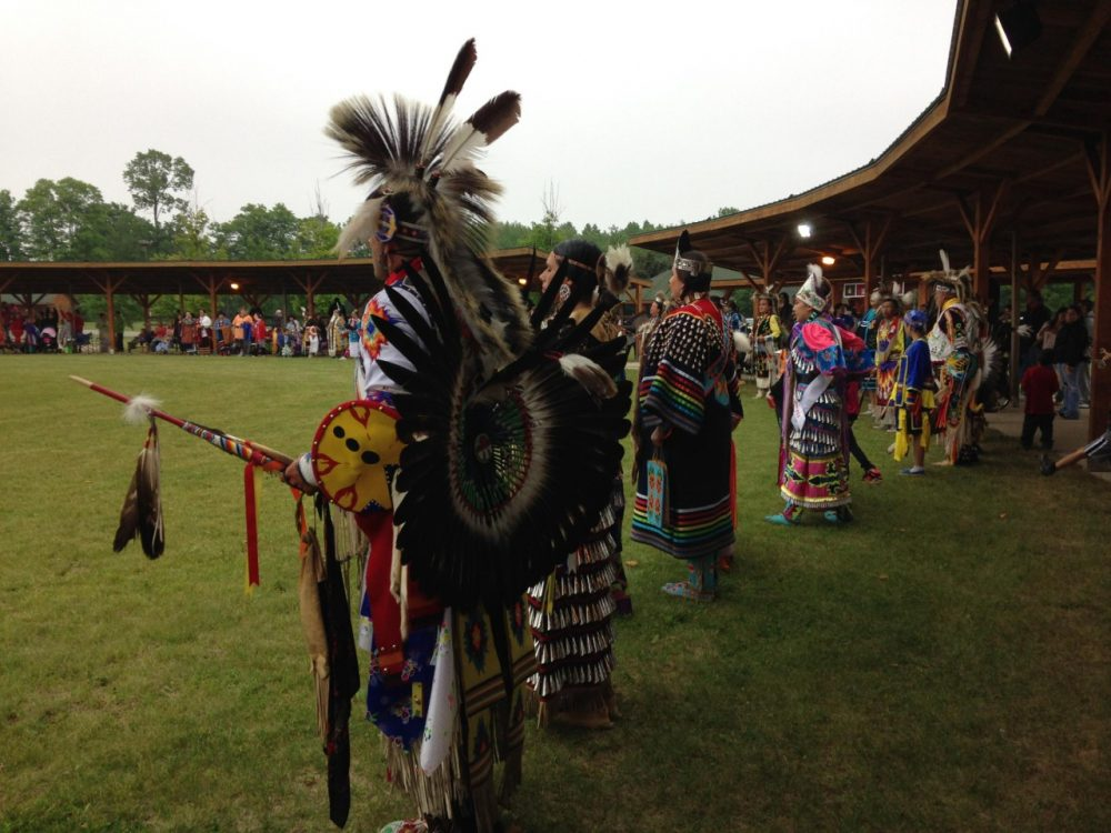 Dancers line up during the Grand Entry at the Hannahville Pow Wow. (Emily Fox/Michigan Radio)