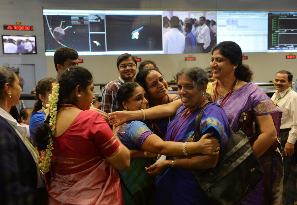 Indian Prime Minister Narendra Modi makes his first visit to the U.S. as India becomes the first Asian nation to reach Mars. Pictured, Indian staff from the Indian Space Research Organisation (ISRO) celebrate in Bangalore after the Mars Orbiter Spacecraft (MoM) successfully entered the Mars orbit on September 24, 2014.(Manjunath Kiran/AFP/Getty Images)