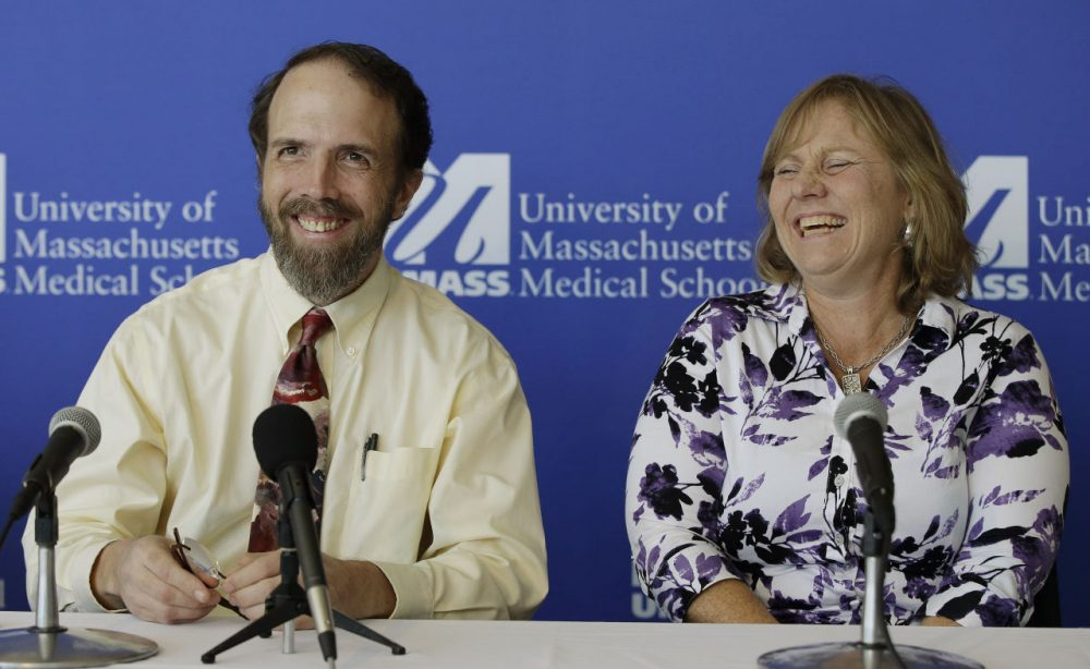 Dr. Rick Sacra, an American doctor who contracted the Ebola virus in Africa and his wife Debbie, enjoy a moment of levity during a news conference at the University of Massachusetts Medical School on Sept. 26. (Stephan Savoia/AP)