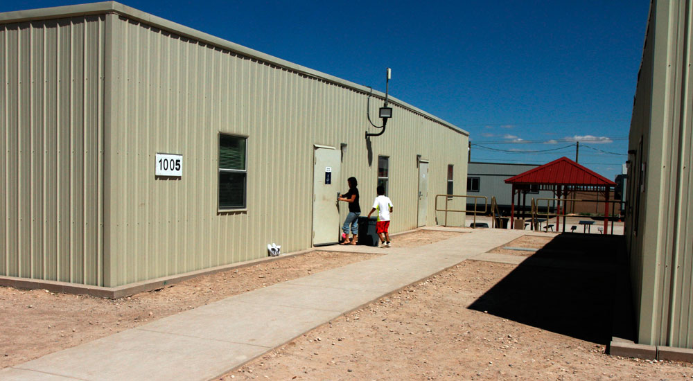 Children are seen entering a dormitory in the Artesia Family Residential Center, a federal detention facility for undocumented immigrant mothers and children in Artesia, N.M, on Sept. 10. (Juan Carlos Llorca/AP)