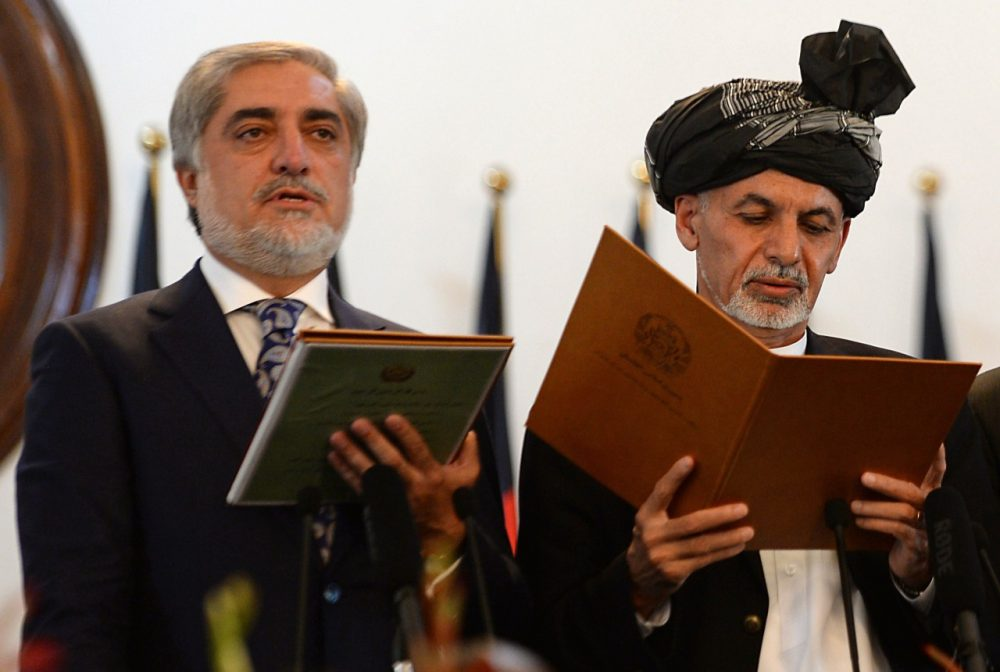 Newly-sworn in Afghan President Ashraf Ghani (R) administers the oath to Abdullah Abdullah (L) as Afghanistan's new Chief Executive during the swearing in ceremony for the country's new president on September 29, 2014. (Shah Marai/AFP/Getty Images)