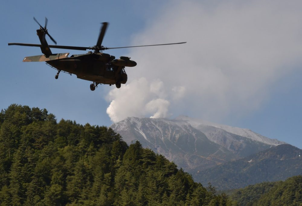 A military helicopter leaves a temporary landing site for a resque mission on Mount Ontake in Otaki, Nagano prefecture on September 29, 2014.  (Kazuhiro Nogi/AFP/Getty Images)