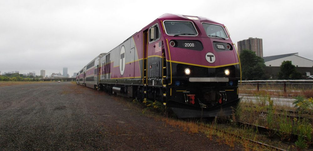 A new commuter rail train was parked in the Beacon Park Rail Yard  in Allston. Governor Patrick announced on September 30, 2014 that a new MBTA commuter rail station will be built in the area. (Zeninjor Enwemeka/WBUR)