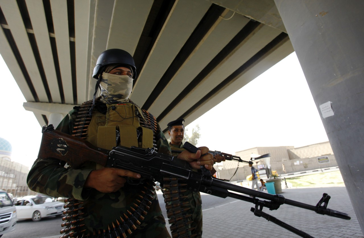 Iraqi security forces stand guard in the holy city of Najaf, on September 30, 2014. The holy Shiite city of Najaf has gained prominence as a centre of political and military power since the start of a crisis that has raised the spectre of Iraq breaking up along sectarian and ethnic lines. (Haidar Hamdan/AFP/Getty Images)