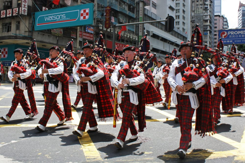 Members of the Hong Kong Police Band march in a parade playing bagpipes and dressed in tartan; two prominent cultural Scottish symbols.(Flickr/istolethetv)