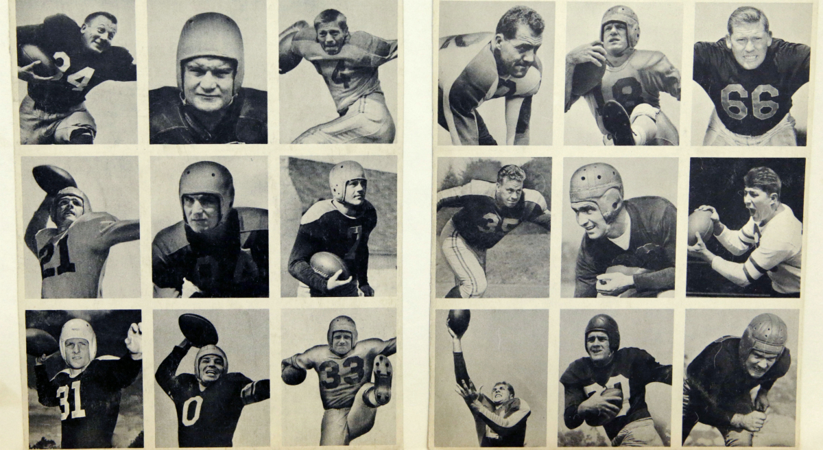 """Steve Almond: """"When I wrote my new book criticizing football, I expected tons of hate mail. What I didn't expect was support."""" Pictured: This 1948 rare uncut set of Bowman football trading cards shown at the Metropolitan Museum of Art in New York, ushered in the modern era of football cards. (Kathy Willens/AP)"""