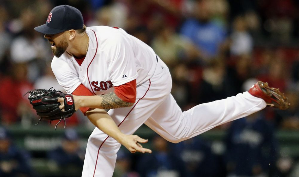 Boston Red Sox's Anthony Ranaudo follows through on a pitch during the first inning of a baseball game against the Tampa Bay Rays in Boston, Wednesday night.  (Michael Dwyer/AP)