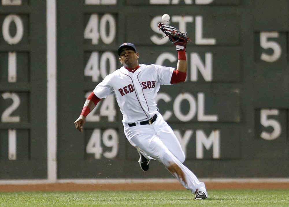 Boston Red Sox's Yoenis Cespedes misplays the fly ball by Baltimore Orioles' Adam Jones allowing a run to score during the seventh inning of a baseball game in Boston on Monday. (Michael Dwyer/AP)
