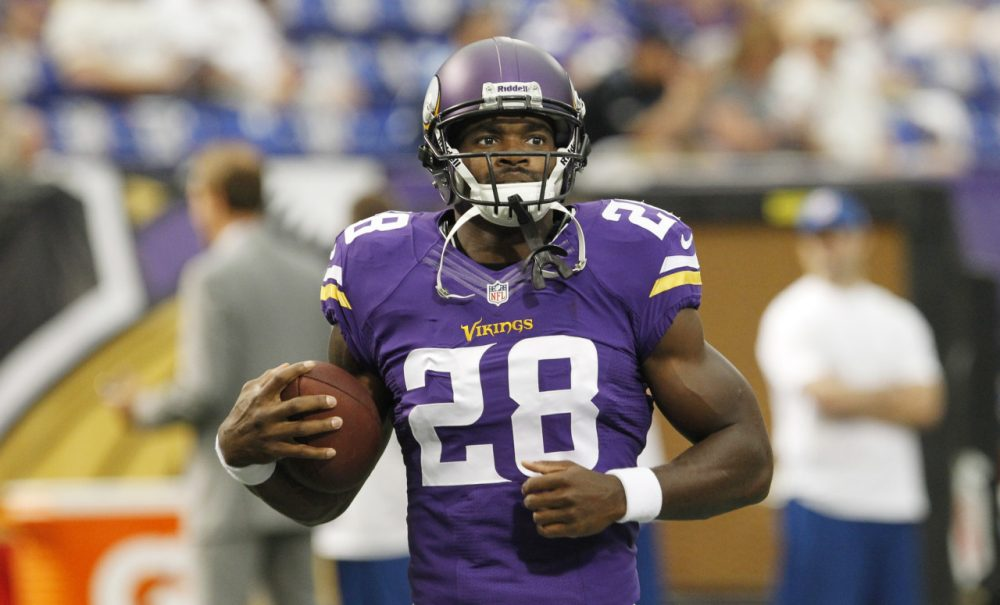 Minnesota Vikings running back Adrian Peterson warms up before an NFL preseason football game against the Tennessee Titans Thursday, Aug. 29, 2013, in Minneapolis. (AP)