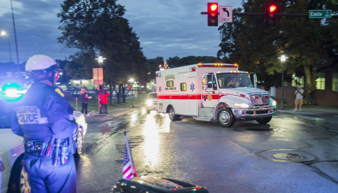 The ambulance transporting Dr. Rick Sacra, who was infected with Ebola while serving as an obstetrician in Liberia, arrives to the Nebraska Medical Center in Omaha Friday. (Nati Harnik/AP)