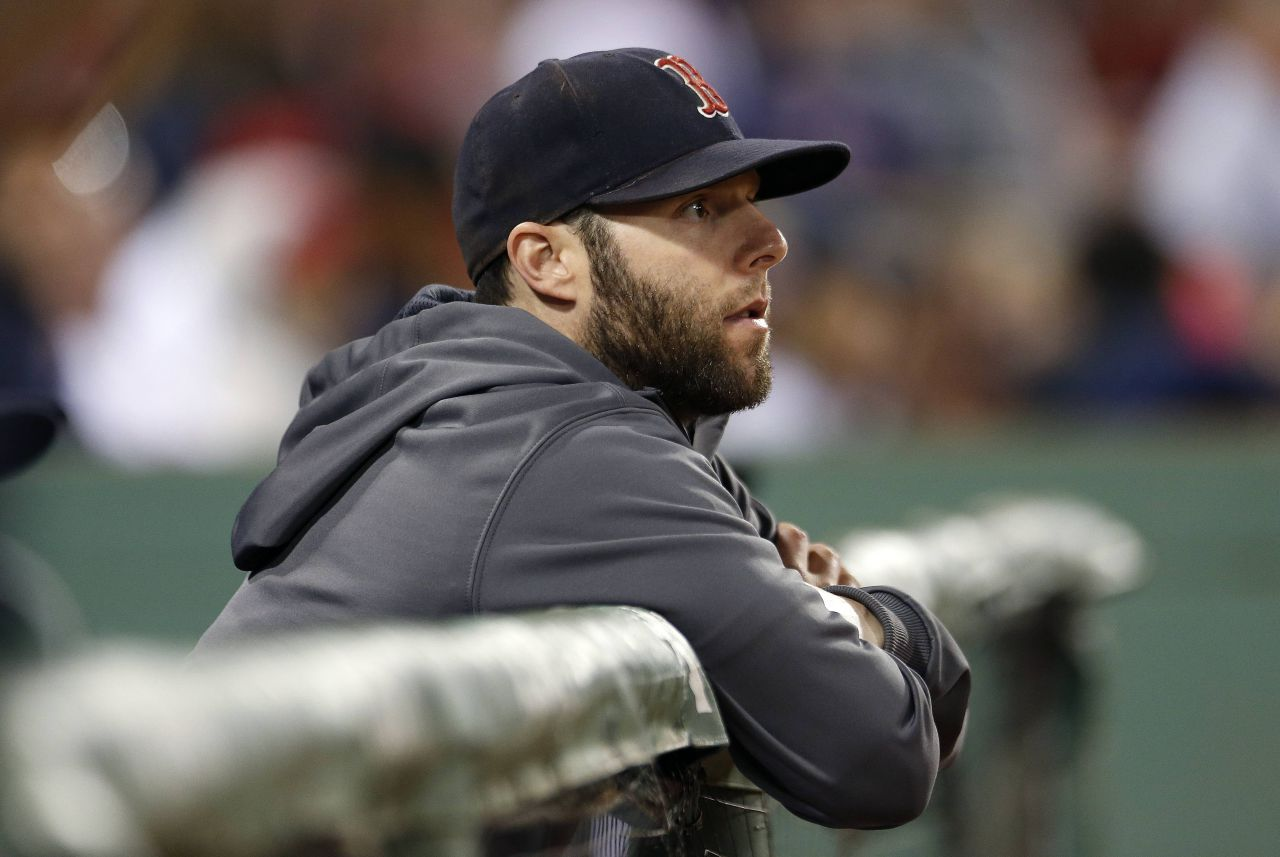 Boston Red Sox's Dustin Pedroia watches from the dug out during the ninth inning of a baseball game against the Baltimore Orioles in Boston Tuesday night. Pedrioia announced after the 4-1 loss that he might be out for the season.  (Michael Dwyer/AP)