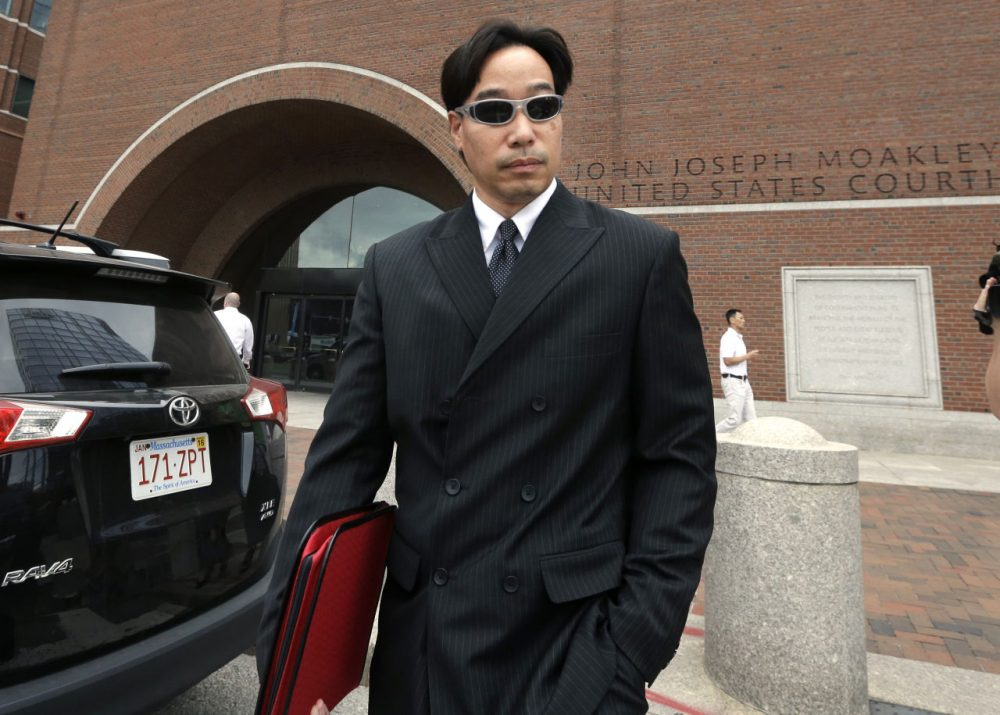 Glenn Adam Chin, former supervisory pharmacist at the New England Compounding Center, leaves federal court in Boston Thursday after pleading not guilty to charges stemming from a deadly meningitis outbreak linked to the Framingham compounding pharmacy. (Steven Senne/AP)