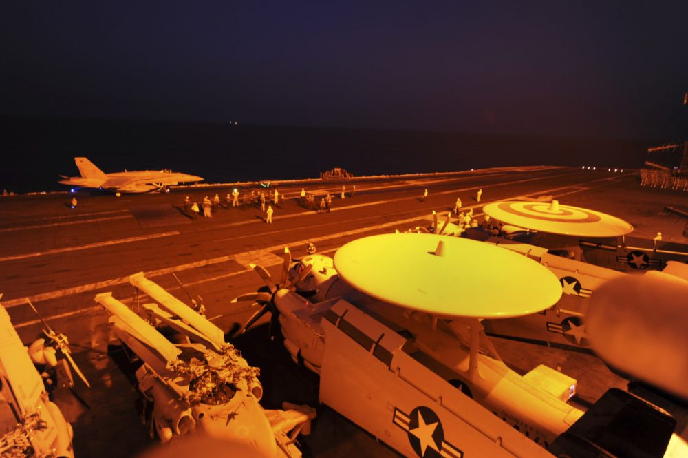In this photo released by the U.S. Navy, A-18C Hornet, attached to Strike Fighter Squadron (VFA) 87, prepares to launch from the flight deck of the aircraft carrier USS George H.W. Bush (CVN 77) to conduct strike missions against Islamic State group targets, in the Arabian Gulf, Tuesday, Sept. 23, 2014. (Robert Burck/U.S. Navy via AP)