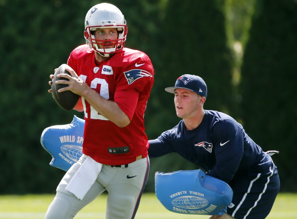 New England Patriots quarterback Tom Brady passes under pressure during a drill at team practice in Foxborough, Mass., Wednesday, Sept. 3, 2014. The Patriots are preparing for their opening NFL football game against the Miami Dolphins on Sunday in Miami. (AP)
