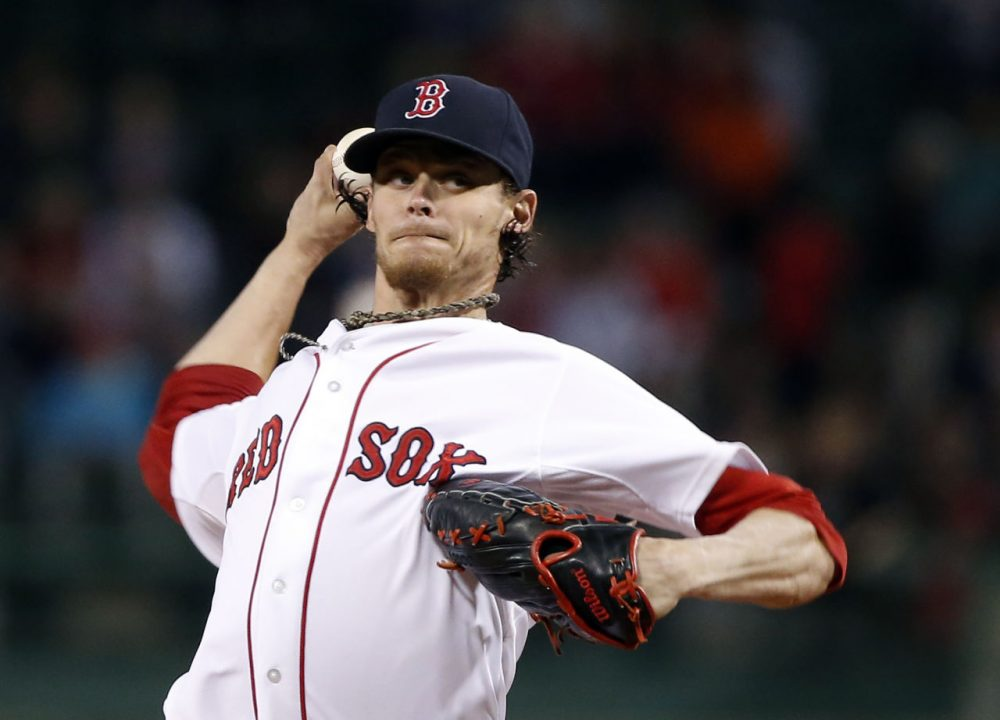 Tampa Bay scored five runs against Boston Red Sox starting pitcher Clay Buchholz with two out in the eighth inning to win 6-2  at Fenway Park in Boston, Tuesday night. (Elise Amendola/AP)