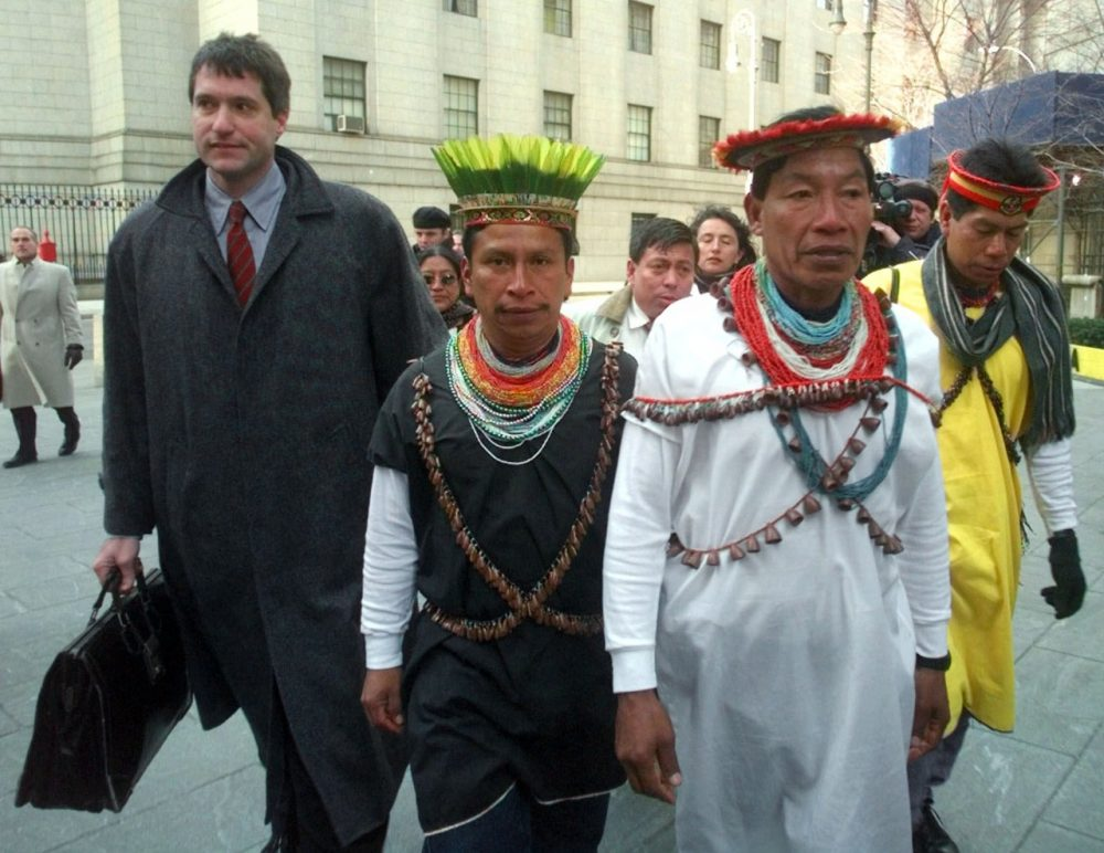 Lawyer Steven Donziger, left, walks with his clients who are members of Ecuador's indigenous Cofan tribe to Federal Court in New York for their hearing with lawyers for Texaco Monday, Feb. 1, 1999. The Ecuadorian rainforest was polluted by Texaco oil drilling. (Adam Nadel/AP)