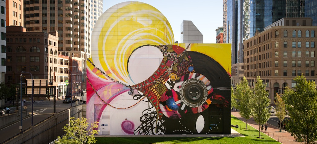 "The Greenway Wall in Dewey Square has a new look -- a colorful mural called ""Seven Moon Junction"" created by artist Shinique Smith. (Geoff Hargadon via Rose Kennedy Greenway Conservancy)"