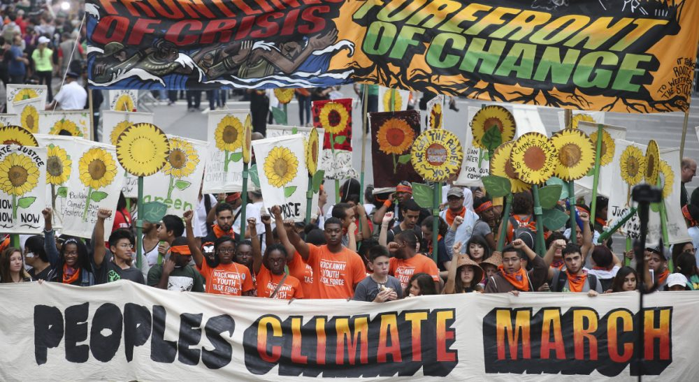 "Christopher Knittel: ""True political change doesn't necessarily happen by marching in front of world leaders and others who already largely agree with you."" Pictured: An estimated 400,000 people marched through midtown Manhattan on Sunday, Sept. 21, 2014 as part of the People's Climate March, a worldwide mobilization calling on world leaders meeting at the UN to commit to urgent action on climate change. (John Minchillo/AP)"